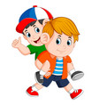 strong boy is carrying his friend on his back vector image vector image