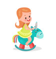 sweet little redhead girl playing blue rocking vector image vector image