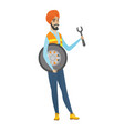 young hindu mechanic with tyre and spanner vector image vector image