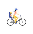 mother riding a bike with daughter in baby seat vector image vector image