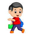 cute boy walking with books vector image vector image