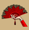 female hand with red open fan vector image