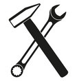black white crossed hammer and wrench silhouette vector image