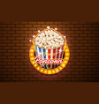 light sign popcorn brickwall background vector image vector image