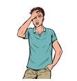 a young man holds his hand to his head headache vector image vector image