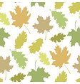 seamless pattern with autumn leaves silhouettes in vector image