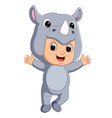 cute boy cartoon wearing rhinoceros costume vector image vector image