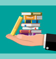 pile books in hand vector image vector image