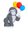 gorilla standing and holding the colorful balloon vector image vector image