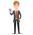 handsome businessman in suit holding coffee vector image vector image