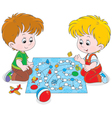 Boys playing with a boardgame vector image