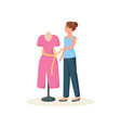 seamstress standing near mannequin in red dress vector image vector image