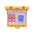 case with travel book pencil and red sneakers vector image vector image