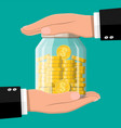 glass money jar full gold coins and hands vector image