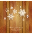 White snowflakes on a wooden background vector image