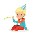 cute baby boy wearing a party hat sitting with vector image vector image