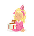 cute smiling baby girl wearing a pink party hat vector image