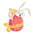 easter bunny sitting on decorative egg wrapped vector image