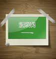 Flags Saudi Arabia at frame on wooden texture vector image vector image