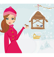 girl feeds the birds in winter vector image