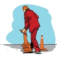 Road worker puts traffic cones vector image