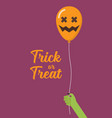 green zombie hand holding scary air balloon vector image