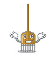 grinning cartoon rake leaves with wooden stick vector image vector image