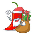 santa with gift red chili pepper isolated on vector image vector image