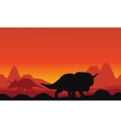 Silhouette of dinosaur triceratops with mountain vector image vector image