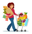 woman with a shopping cart buying food vector image