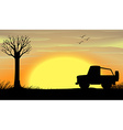 Silhouette sunset scene with a truck vector image vector image