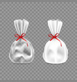 white and transparent plastic candy packs with bow vector image