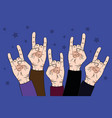 people raise rock hands up in concert with on vector image