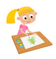 little girl artist at a table and painting vector image vector image
