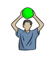 man holding green ball over head vector image