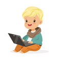 cute little boy sitting and using laptop for vector image vector image