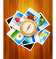 Travel photos and compass on wood background vector image vector image