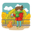 a young woman is planning to feed a stray cat vector image vector image