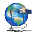 planet earth with hand using electric drill oil vector image vector image