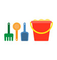 Pail with sand shovel and rake for a sandbox