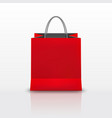 realistic red paper shopping bag with handles vector image vector image