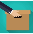 Hand carrying a cardboard box vector image