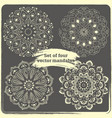 set of 4 hand drawn mandalas vector image