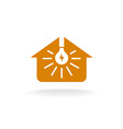 Light bulb with rays inside of a house silhouette vector image vector image