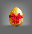 realistic golden easter egg tied of red ribbon vector image