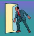 african man opens door vector image vector image