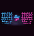 realistic neon alphabet on dark brick wall vector image