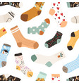 seamless texture with cute cotton and woolen socks vector image vector image