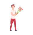 smiling romantic young man standing with bouquet vector image vector image
