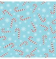 Christmas seamless blue pattern with candy canes vector image vector image